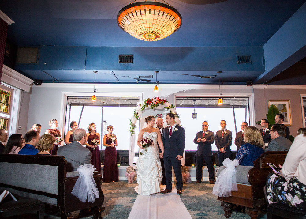 After being pronounced husband and wife during the wedding ceremony at Ocean 13, Jenna and Bill receive applause from family and friends.
