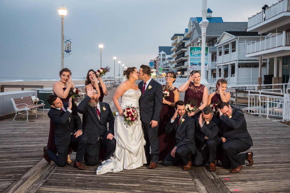 The bridal party escape for fun and formal portraits before introductions during the reception hour at Ocean 13 in Oc.