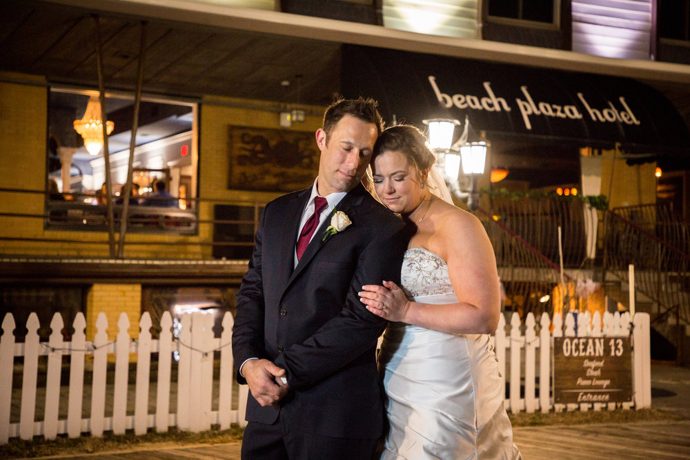 Jenna and Bill take a moment together outside their wedding venue, Ocean 13 in Ocean City, MD.