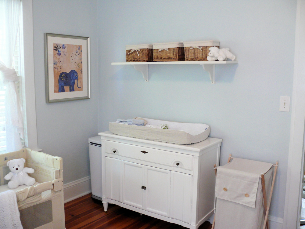 Organized simple nursery with upcycled changing table
