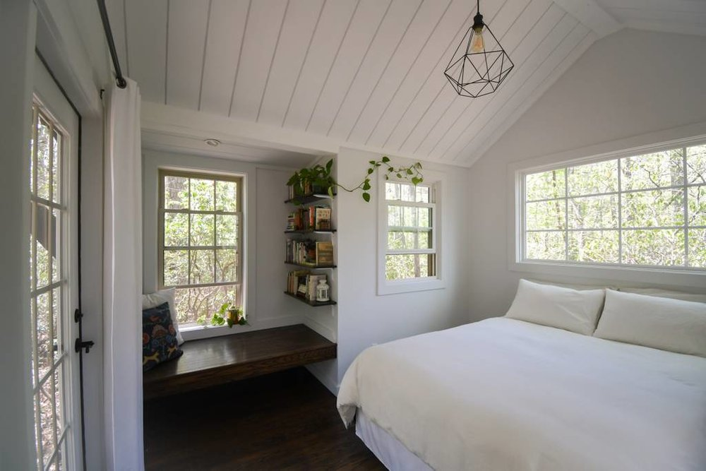 Tiny House Airbnb in North Carolina — Love the reading nook window seat!