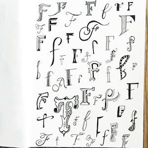 Pretty hand lettering calligraphy.  Letter F by Nicki Traikos, lifeidesign.com