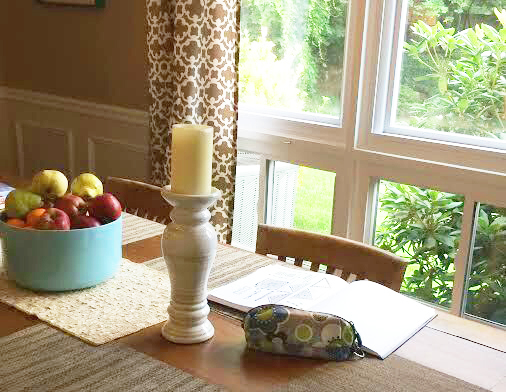 Setting up a workspace at the kitchen table and in front of natural lighting is key!