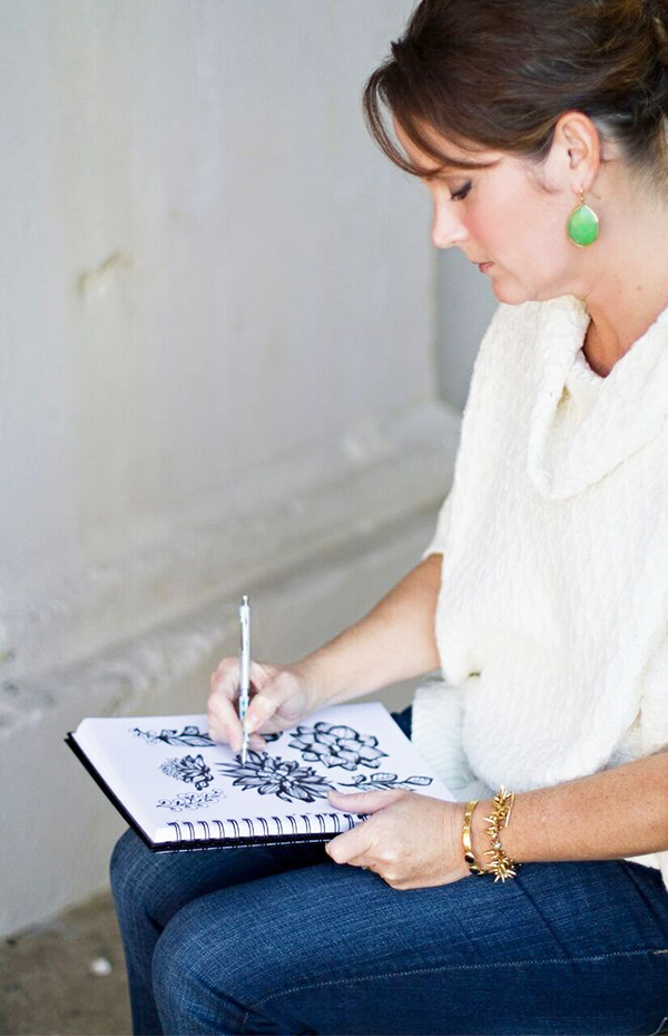Amy Reber sketching in her sketchbook featured on life i design's blog series of Creative Women.