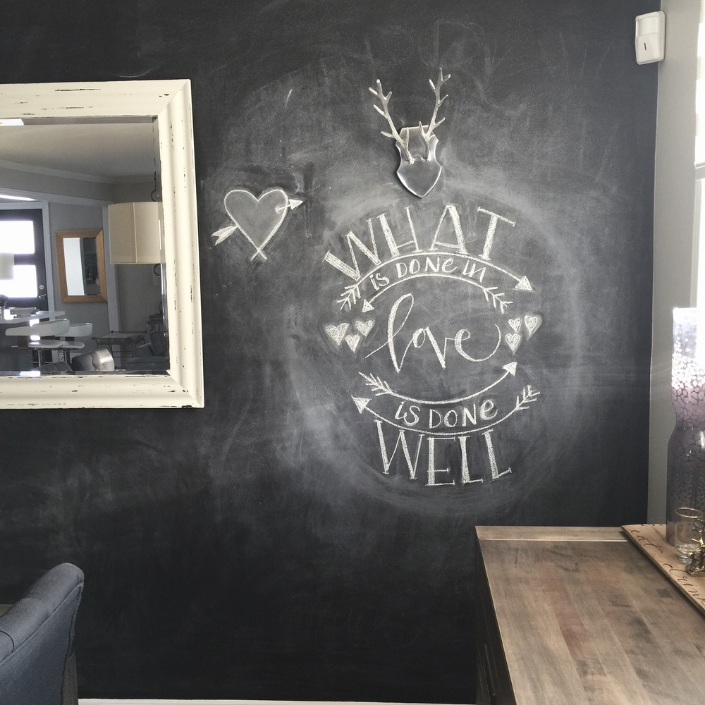 Chalk lettering on feature wall in dining room is an easy and fun way to inspire conversation and creativity!