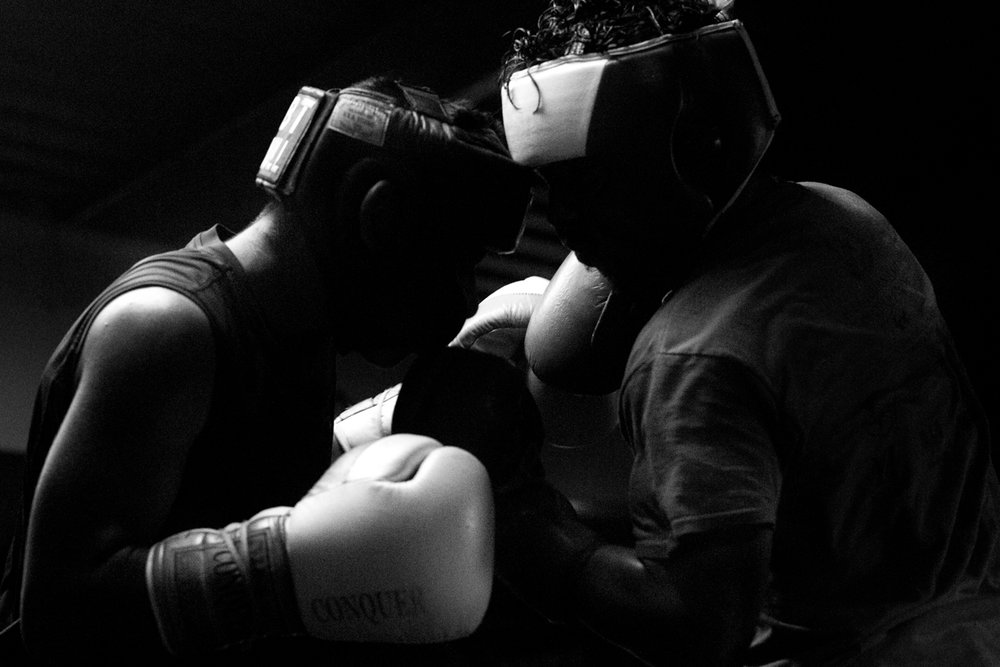 Gustavo Garrido Sr. and Angel Colundres, 16, face off during a sparring match at the Ramos Boxing gym on April 20, 2017 in San Antonio, Texas. The members of the Ramos Boxing Junior Olympics Team spar every Tuesday and Thursday as they prepare to compete in regional and national competitions.