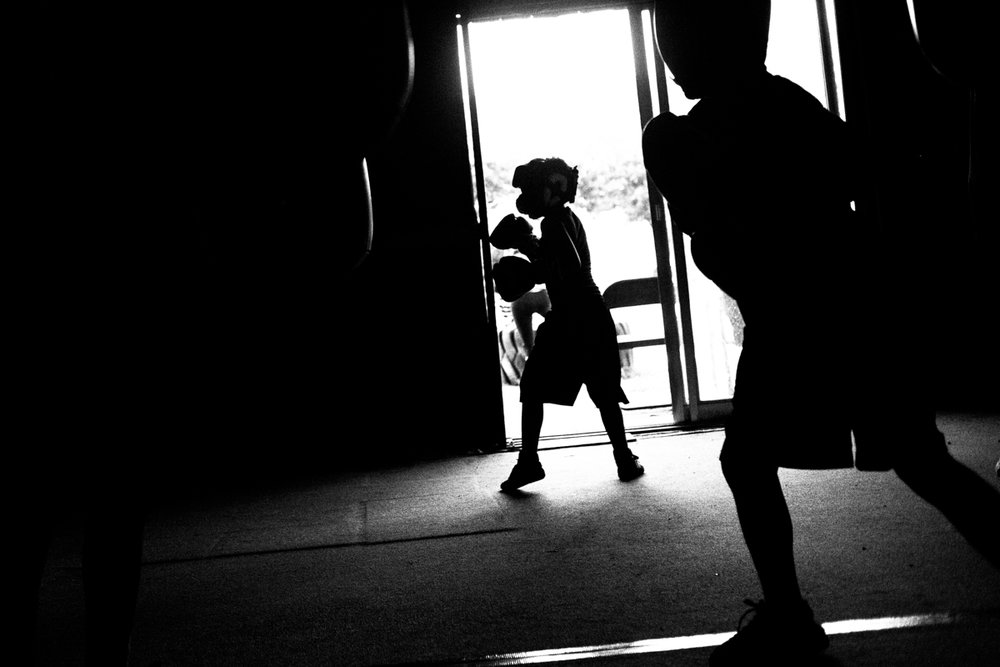 As part of a drill, Miguel Ángel Jacobo Jr., 9, repeatedly punches a bag while he waits for his turn to spar with a teammate at Ramos Boxing gym in San Antonio Texas. As a member of the gym's Junior Olympics Team, Jacobo competed at the South Texas Junior Olympic Championships in Laredo, Texas, on April 28. Lynda Gonzalez/Reporting Texas