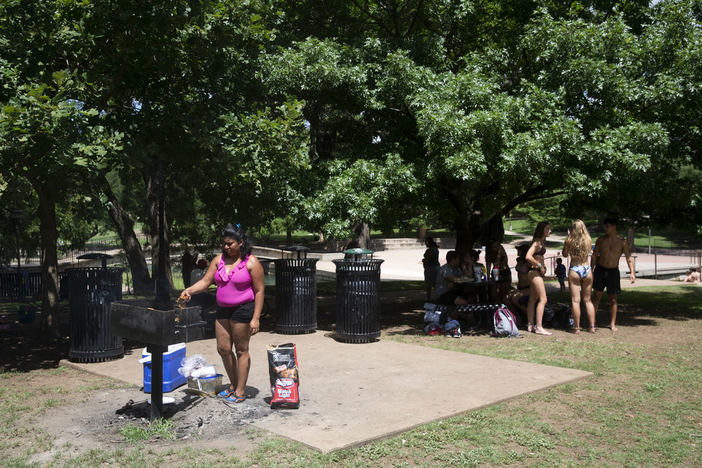 Lizeth Rosales, an asylum recipient from Honduras, grills meat at Texas State University's Sewell Park in San Marcos on June 28, 2018. Rosales received asylum in May 2017 as a victim of domestic violence, a circumstance that Attorney General Jeff Sessions said will no longer qualify victims for asylum in the United States. Photographed for the Austin American-Statesman
