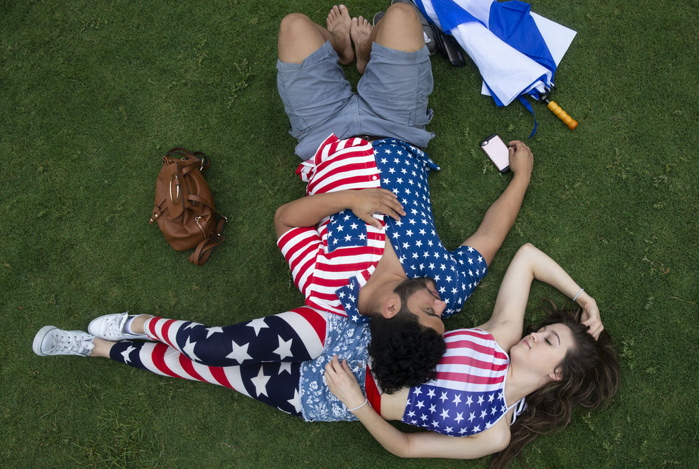 Jonathan Salas and Daisy Escamilla lay down on the Vic Mathias Shores lawn before the H-E-B Austin Symphony July 4th Concert & Fireworks celebration on Wednesday.