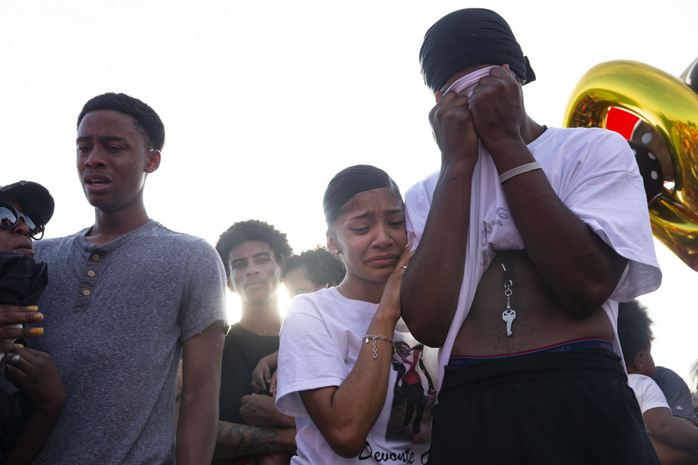 Devonte Ortiz' girlfriend, Amber Garcia, embraces Myke Jones during a memorial held for Ortiz at the Travis High School football field on July 8, 2018. Ortiz, 19, was fatally shot by 41-year-old Jason Roche during a dispute over fireworks early on July 4.