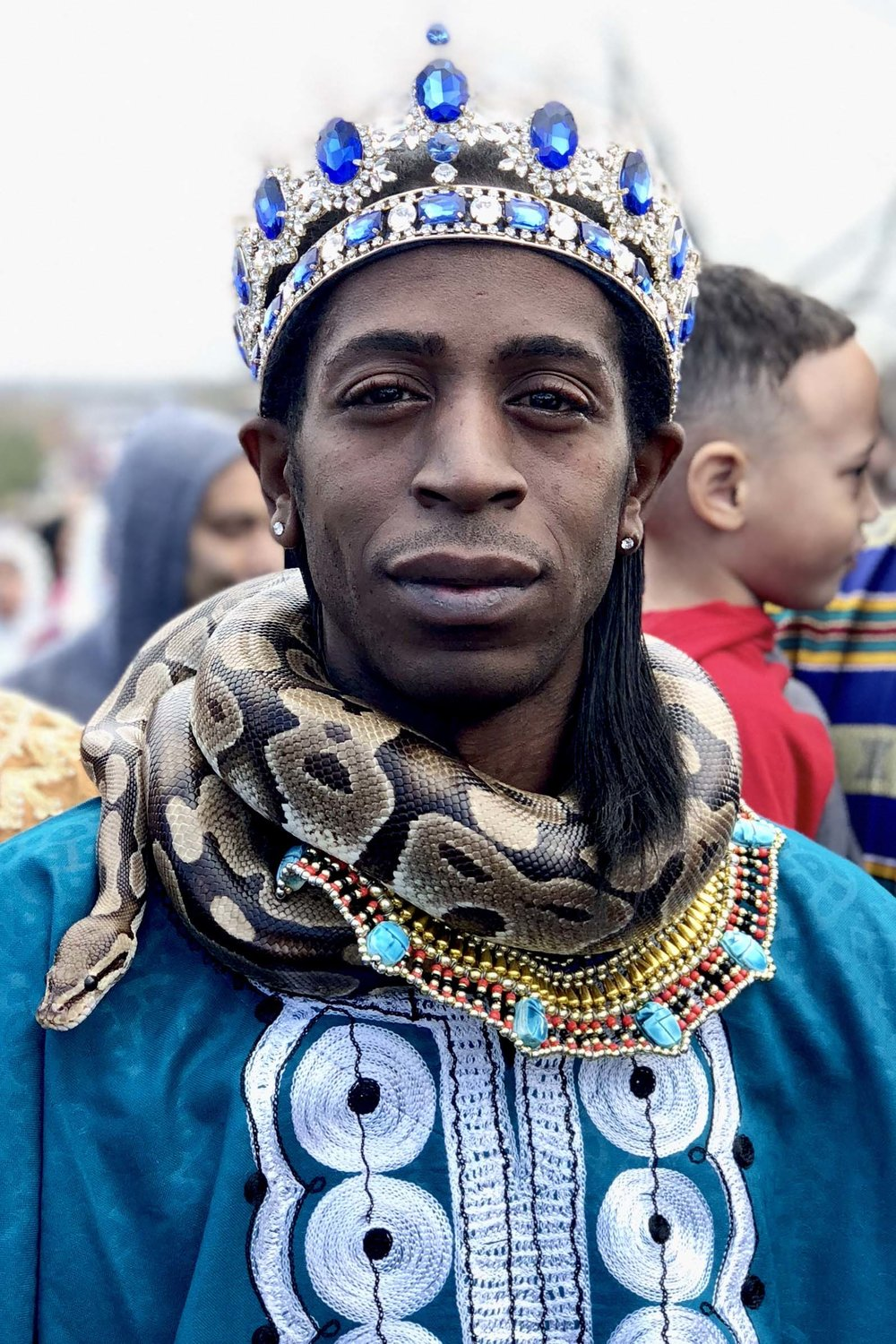 Surrounded by family, Pharaoh Clark and his pet snake, also named Pharaoh, participate in the 50th annual Martin Luther King Day march in San Antonio, Texas, on January 15, 2018.