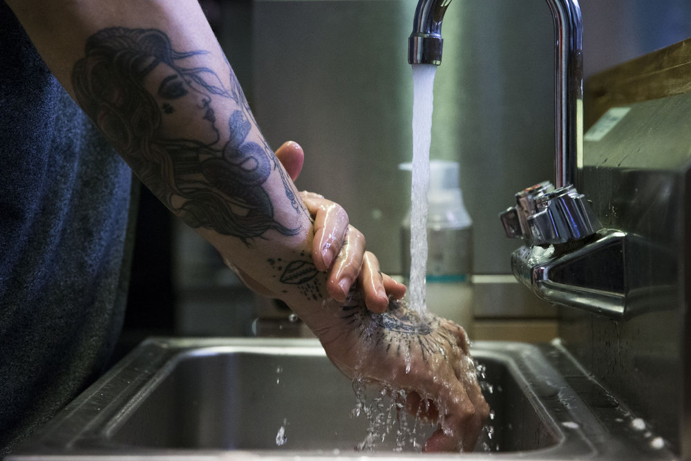 Kagan Kim washes his hands clean at the donation-based, nonprofit Comfort Cafe in Smithville, Texas, on Friday, Nov. 30, 2018. The cafe is staffed by individuals recovering from substance abuse at the nearby SerenityStar recovery center. Kim lives at the center with his partner and infant son.