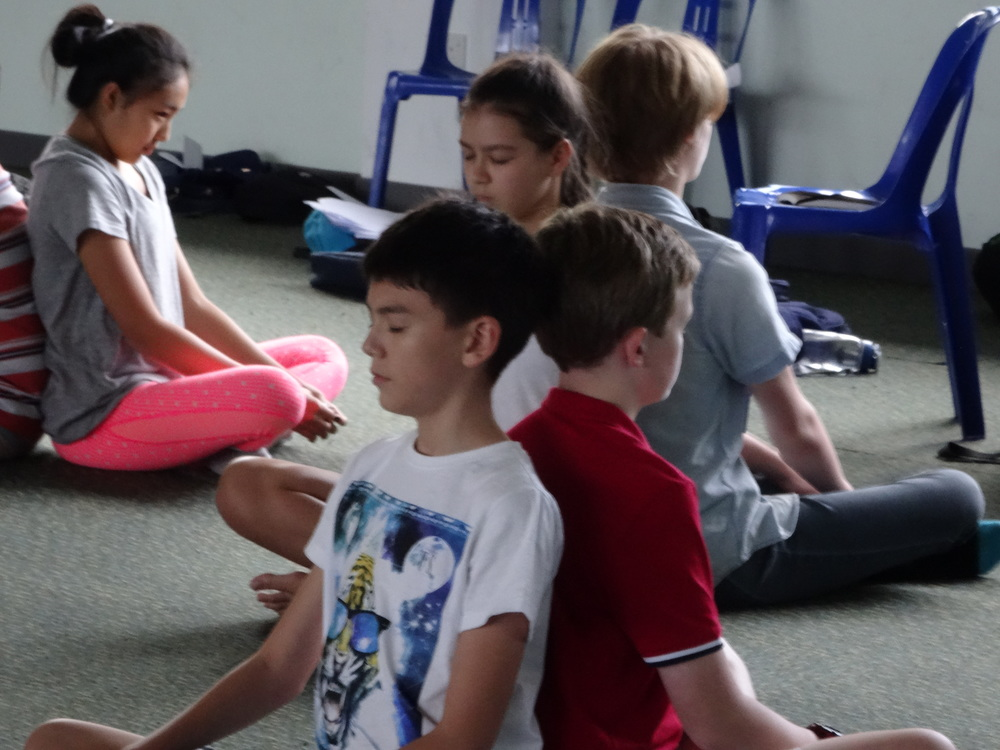 Practising mindful breathing and meditation (225 Academy Singapore)