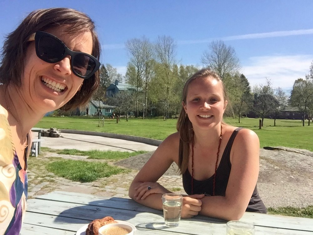 Silvia and I catching a moment of Swedish sun over a kanelbullar (cinnamon bun)!
