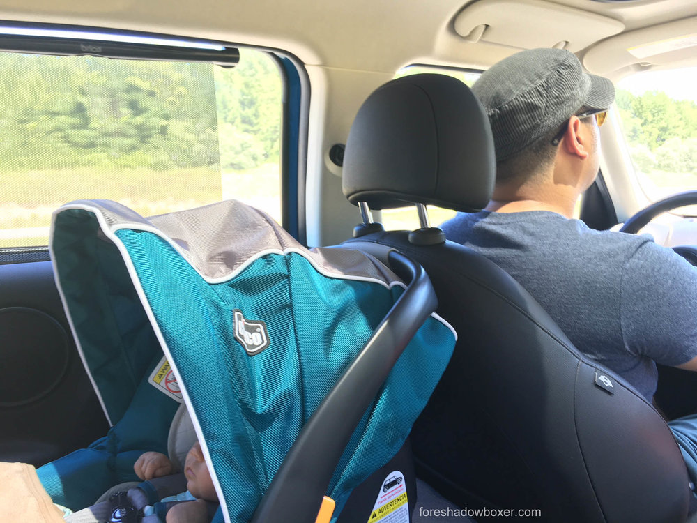 This photo depicts a parenting fail: the car seat is touching the front seat. Once we realized the error, we had to move the car seat to the passenger side, which rendered our front passenger seat completely useless for anyone over 5'5.