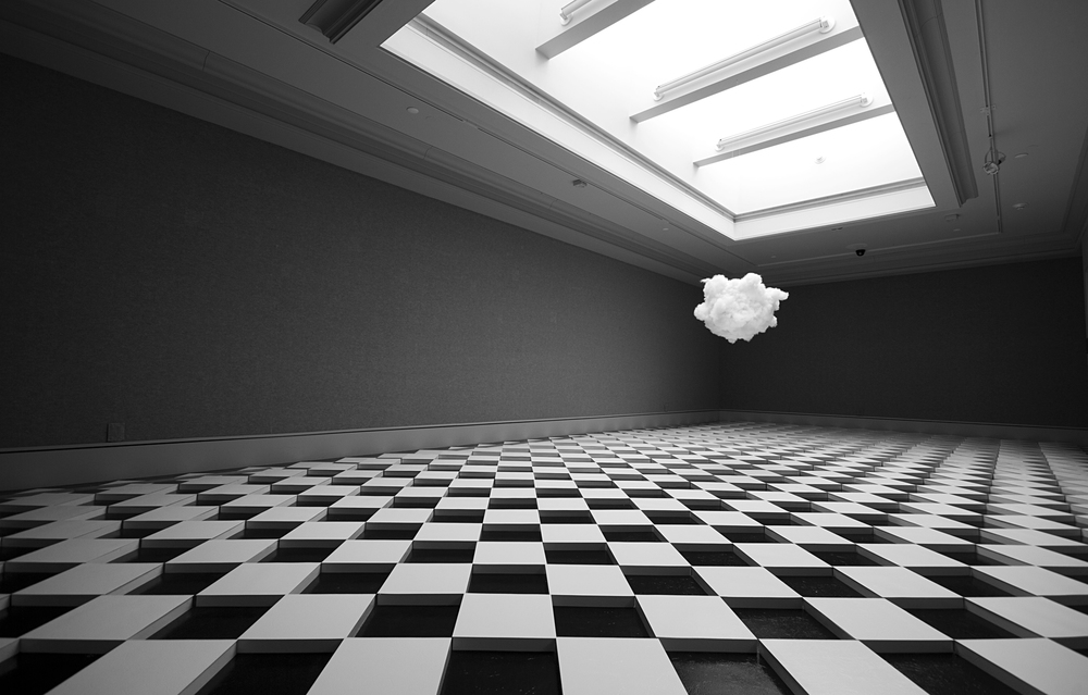 Ying Zhu, Watch your steps, installation view, 2013, cotton candy, floor tile, 63 x 37 x 12 ft. All the white tiles are raised 5 cm off the floor, viewers are invited to walk over the uneven floor and eat pieces of the cotton candy cloud.