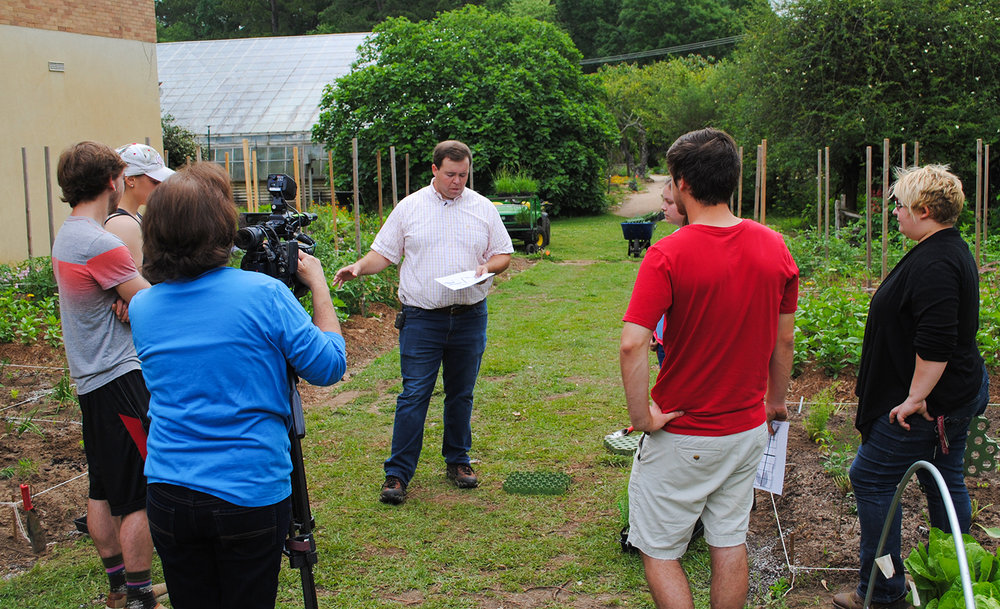 A rare photograph of me teaching as Donna McCollum films a piece on the food prairie plantings.  Photo by Hunter Walker.
