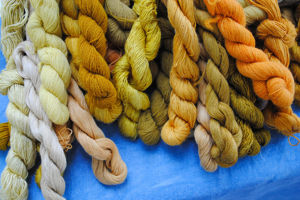 A variety of threads dyed from a plethora of plant pigments.