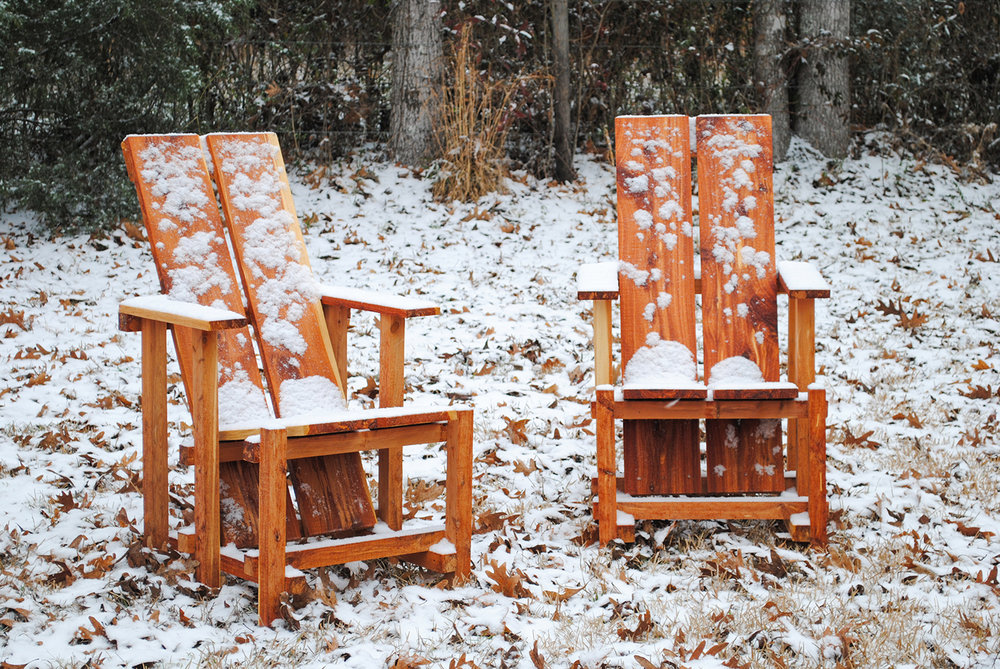 Two farm chairs dusted with a rare snow in Nacogdoches, TX
