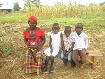 Eron with her children whose school fees she paid