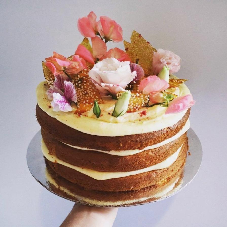 "Crème Brûlée    YES THAT""S RIGHT- Crème brûlée cake. Three layers of fluffy vanilla cake, vanilla-bean buttercream, vanilla custard and crunchy sesame sugar shards.  Gluten free available.  Feeds 12, $90"