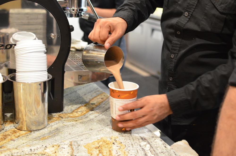 A Tierra Mia barista pouring coffee.