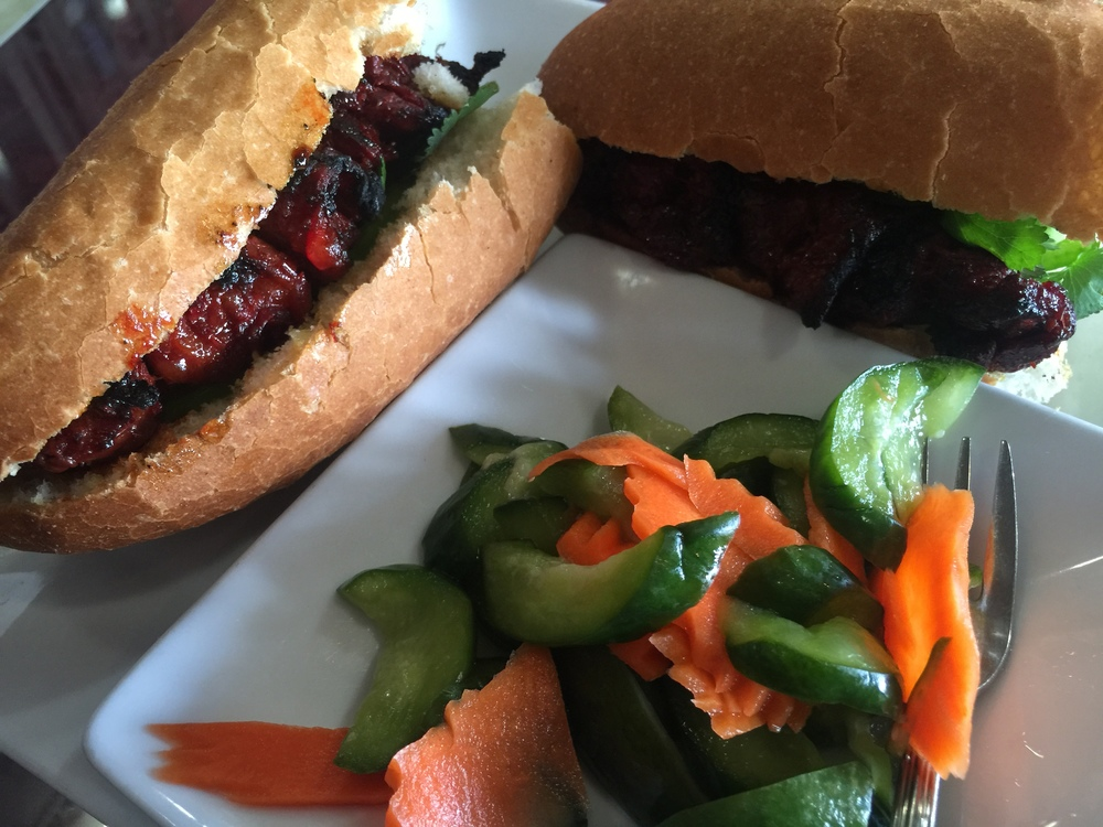 The beef sandwich is served with vegetables for the enjoyment of those who go to Monorom Cambodian Restaurant.