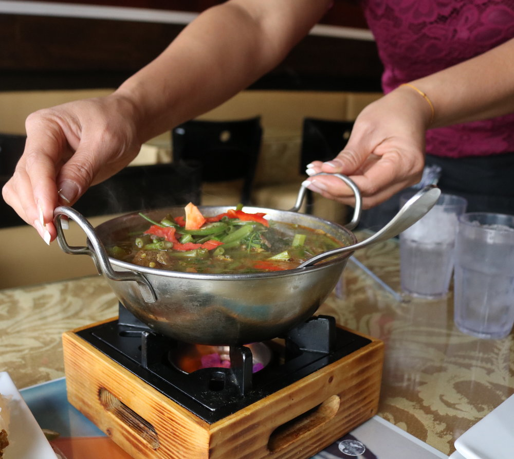A sweet and spicy lemongrass soup called Machu Kreung comes sizzling hot to the table. .JPG