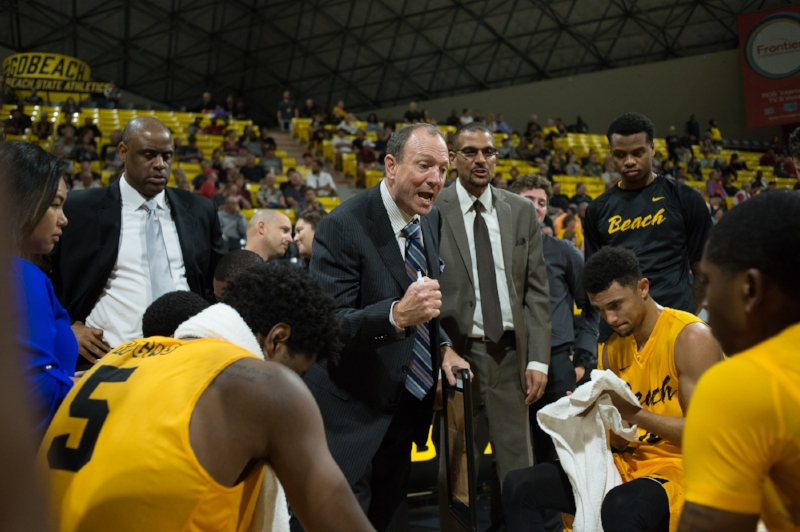 Long Beach State men's basketball head coach imploring his team during the 2017-2018 season.  Credit: Long Beach State Athletics/John Fajardo