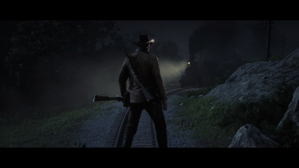 Screenshot By Jacob Ybarra (Playstation 4)  Under the cover of night, you block the tracks as a train approaches, preparing for an armed robbery.