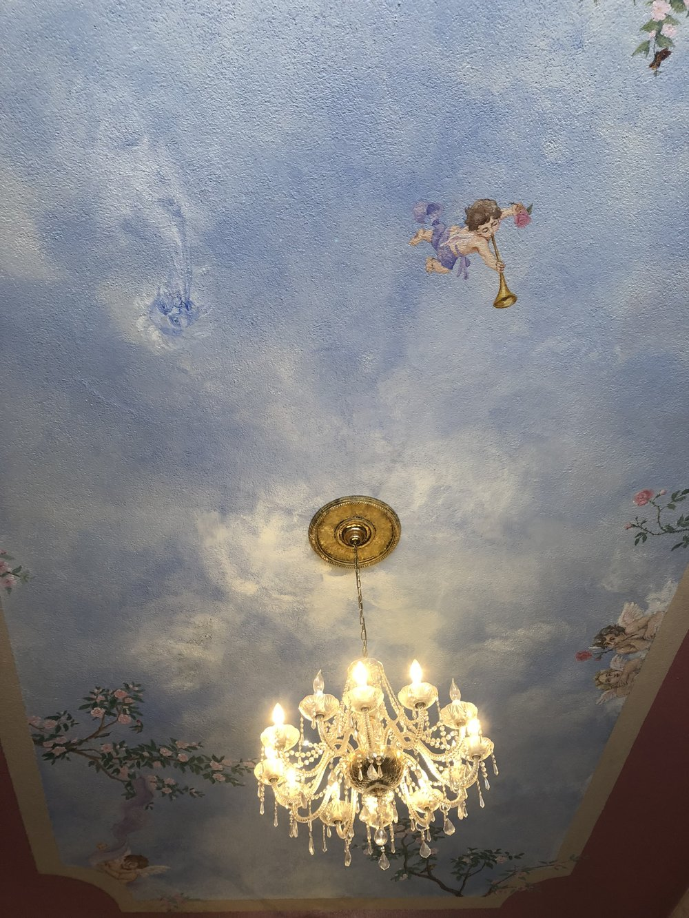 The rococo inspired ceiling of Elise's Tea Room in Long Beach California.