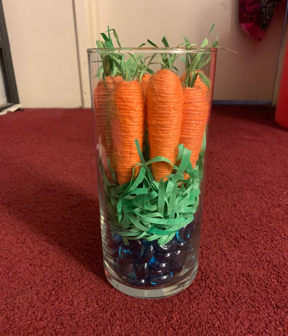 - Step 1: Start with a clear vase and pour the luster gems.Step 2: Then layer it with the famous Easter green grass. There are many colors from pink to yellow grass, but I went with simple green to add more authenticity to the carrots on top.Step 3: Add the Carrot Deco on top of everything.