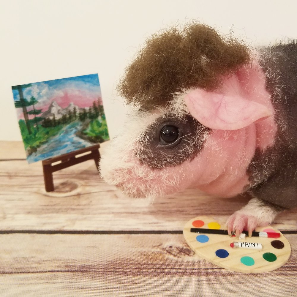 As an art major, Le is a huge fan of Bob Ross so she found a mini easel and had to recreate Ross with Haskins, her guinea pig.