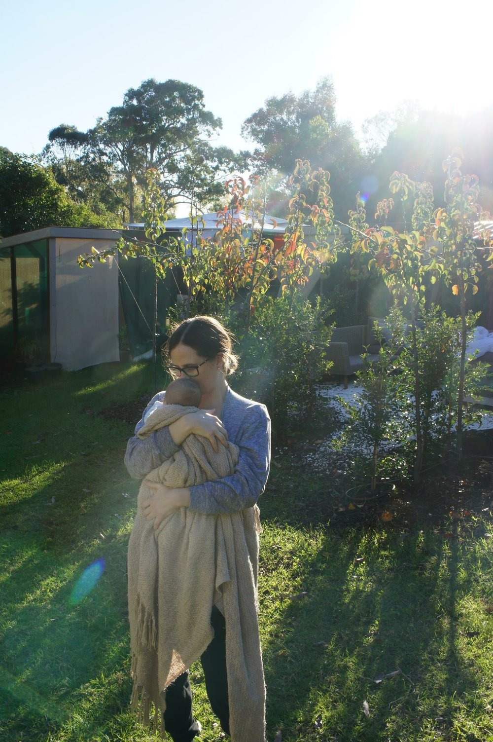 Introducing our son to the chooks and the garden