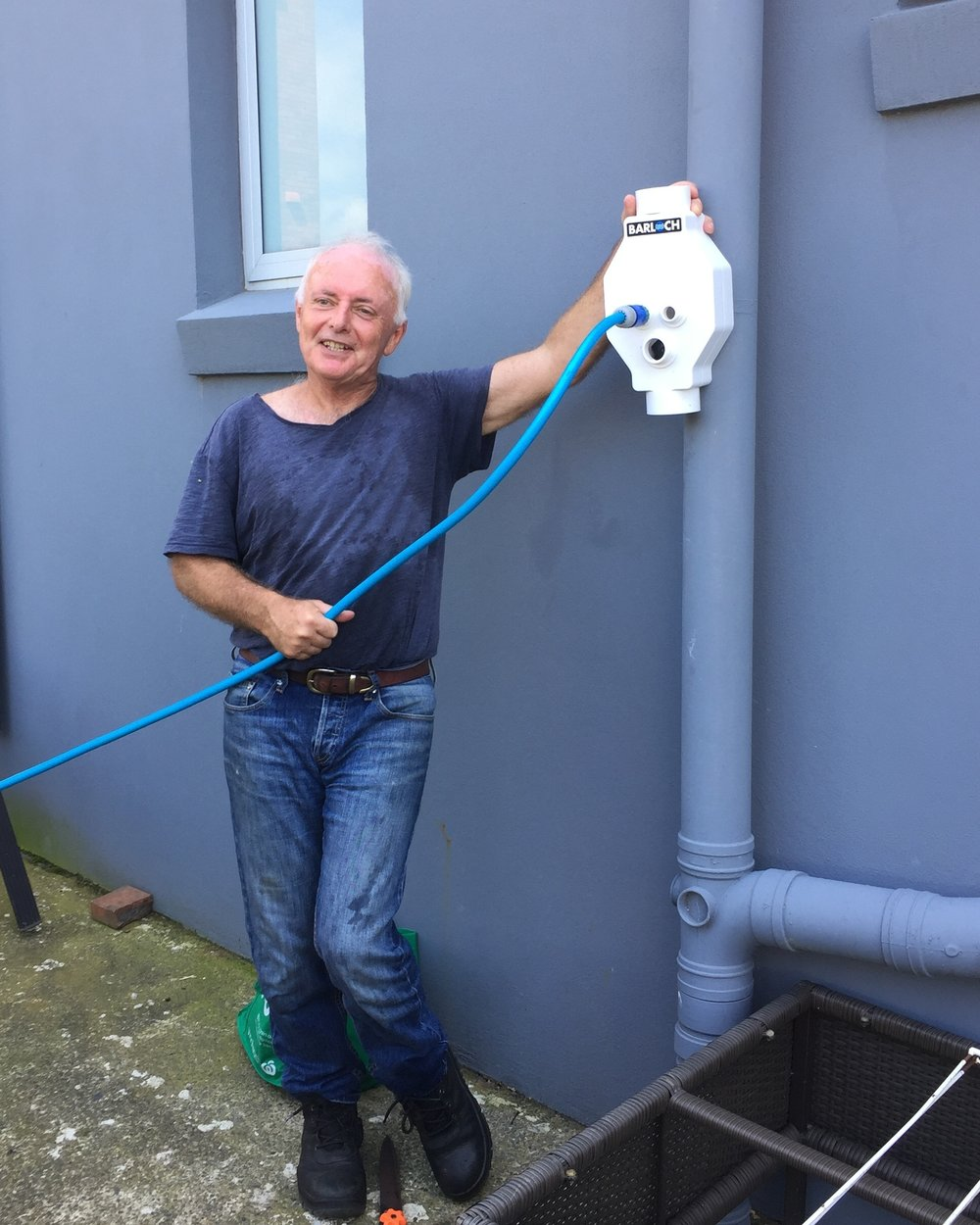 •   Here is an example of a rainwater diverter about to be inserted into a down pipe to direct rainwater to a garden. There are several such products readily available.