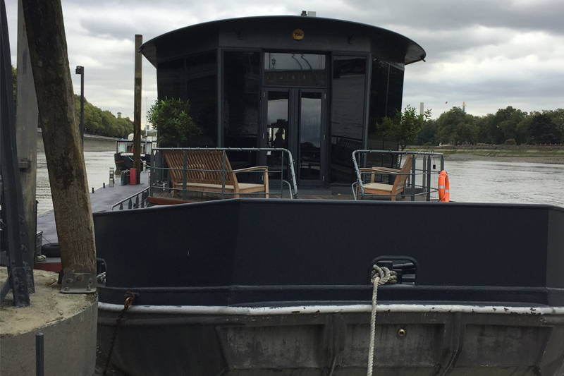 A houseboat at Chelsea Bridge Wharf in London     View Gallery