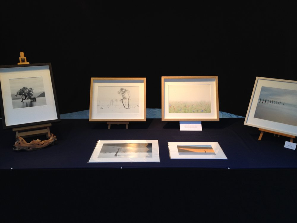 On display are matted prints in various sizes as well as framed pieces.