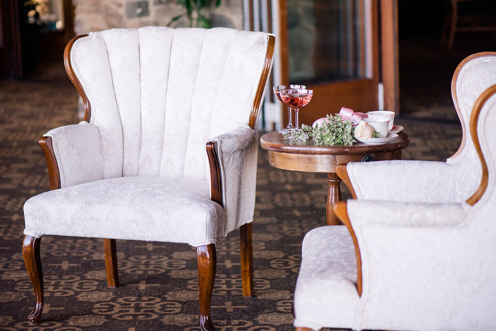 Michelle Channel Back Arm Chair 1 - Provenance Vintage Rentals Los Angeles Sweetheart Table Seating Vintage Lounge White Upholstered Arm Chair Party Rentals Specialty Rentals Los Angeles