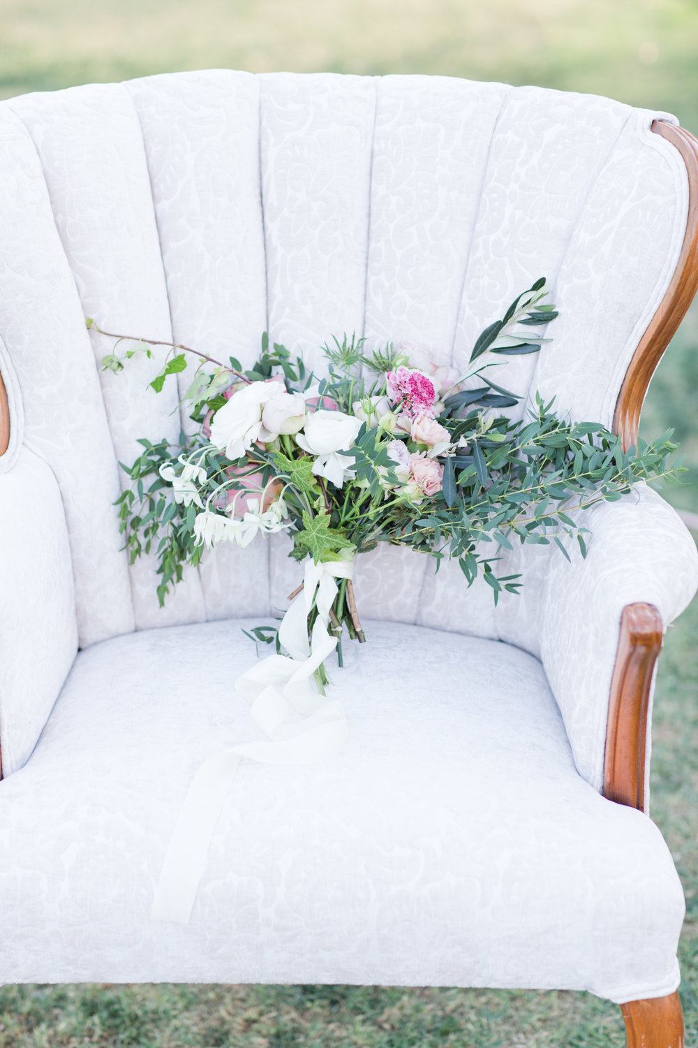 Ronna Channel Back Arm Chair 1 - Provenance Vintage Rentals Los Angeles Sweetheart Table Seating Vintage Lounge White Upholstered Arm Chair Party Rentals Specialty Rentals Los Angeles