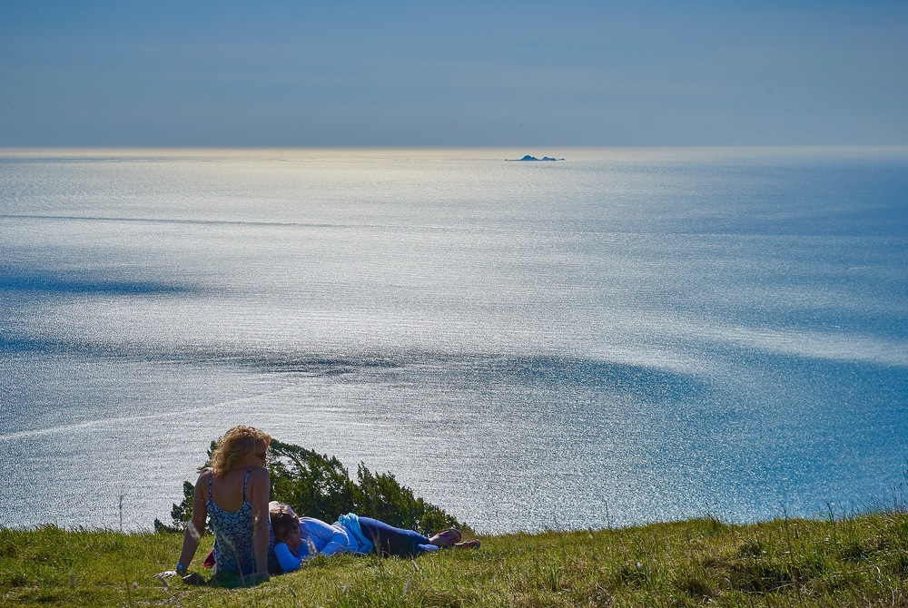 Shiloh and our eldest daughter Savannah resting on a hillside above Stinson Beach. The Farallon Islands can be seen in the distance.