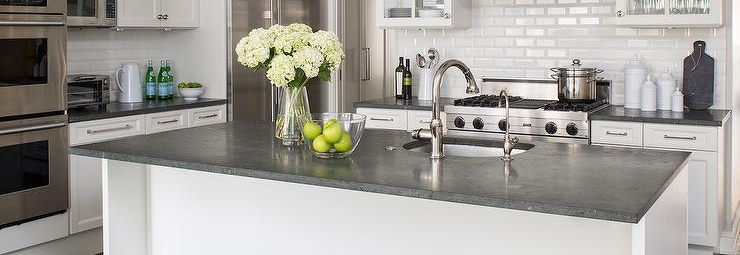 white-kitchen-cabinets-concrete-ocuntertops-beveled-subway-tiles.jpg