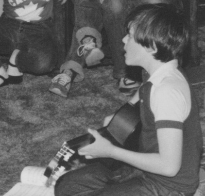 Patrick 10 yrs old foreground on guitar.jpeg