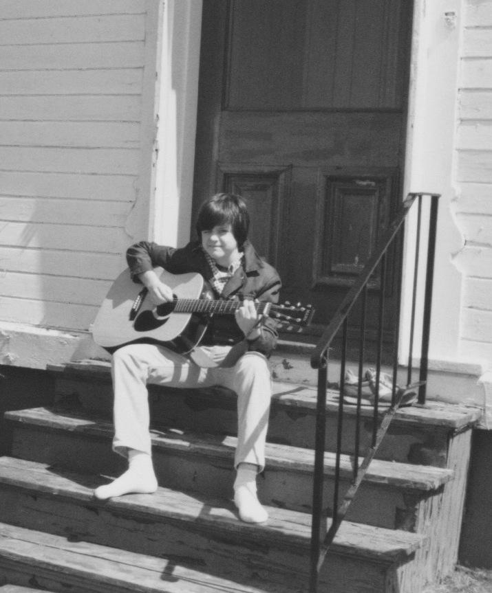 Patrick on guitar 13yrs old.jpeg
