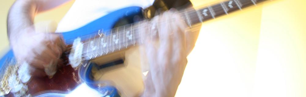 hands on guitar neck.jpg