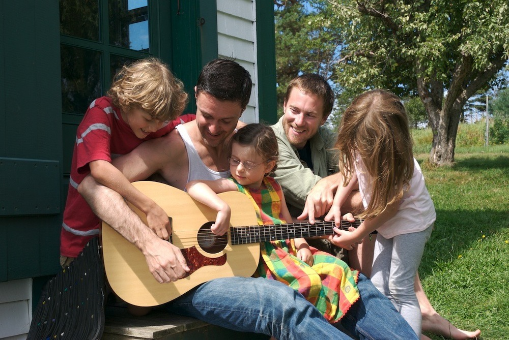 Pat with guitar & family on vacation.jpg