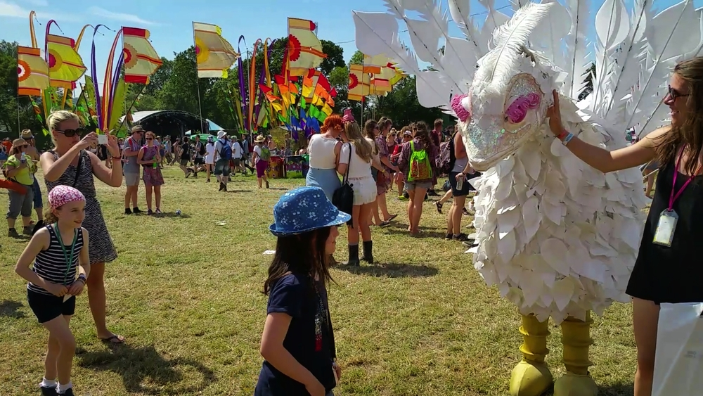 A young family taking photos with The Birds at Glastonbury 2015