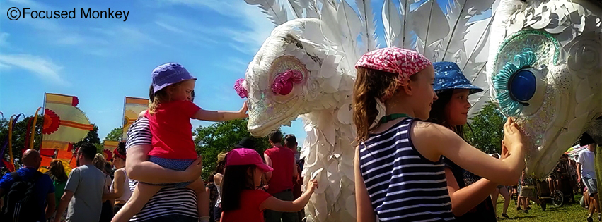 Bluey and Pinky being stroked by children at Glastonbury 2015
