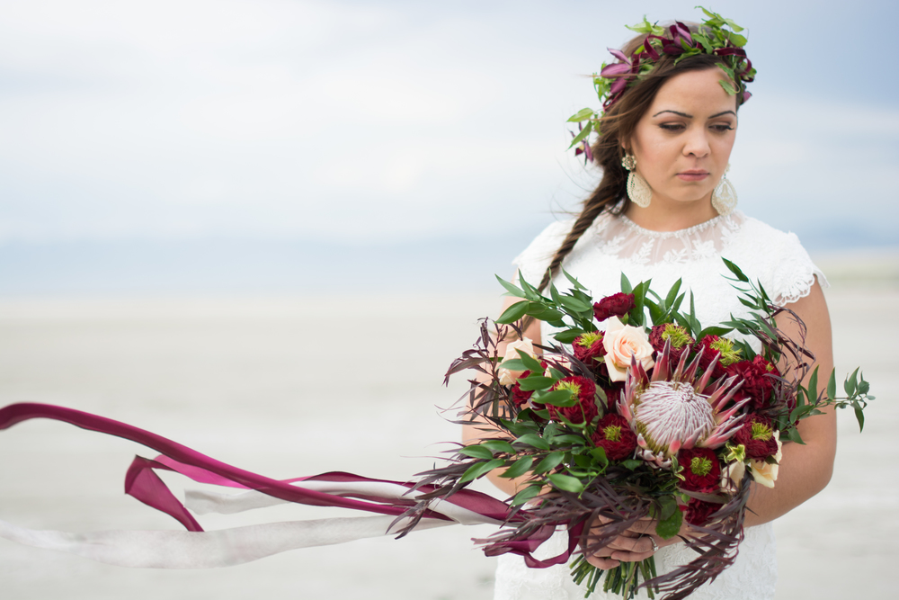 Erin's featured an open Pink King Protea surrounded with Ivanhoe garden roses and cream Sahara Rose accents. The bouquet and location set a wonderful tone for her these bridals.