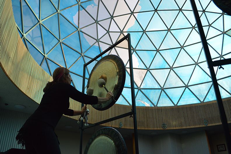 Patti Pellerito using her gongs to fill the dome with good vibrations.