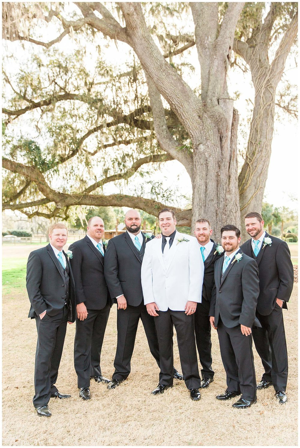 ocala-gainseville-wedding-rembert-farm-photographer-candid-lifestyle-gainseville-florida-photography-natural-rustic-bride-groom-teal_0243.jpg